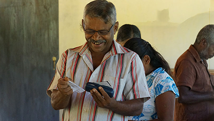 Photo of an elder who is enjoying his new Spectacles